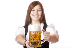 Happy Bavarian woman holds Oktoberfest beer stein Stock Image