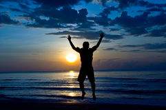 Happy on the beach. Silhouette of man feel free and happy on the beach Stock Photography