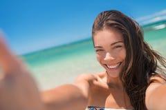 Happy beach vacation asian girl taking swim selfie Stock Photo