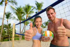 Happy beach volleyball players thumbs up Royalty Free Stock Photography