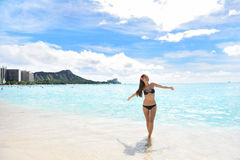 Happy beach woman in bikini on Waikiki Oahu Hawaii stock images