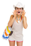 Happy beach woman shouting through megaphone shaped hands Stock Photography