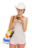 Happy beach young woman looking photos in camera Royalty Free Stock Photography