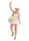 Happy beach young woman saluting Stock Image