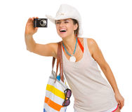 Happy beach young woman taking photo with camera Stock Images