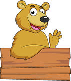Happy bear with blank signboard Stock Images