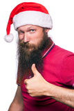 Happy bearded happy man with red hat and t-shirt, studio shot. Royalty Free Stock Photography