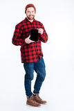 Happy bearded hipster guy showing blank monitor over white background Royalty Free Stock Image