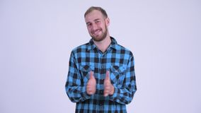Happy bearded hipster man clapping hands. Studio shot of bearded hipster man against white background stock footage