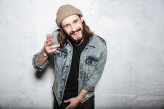 Happy bearded hipster man gesturing with hands. Stock Photos
