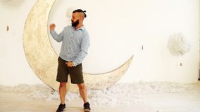 A happy bearded man is dancing. stock video