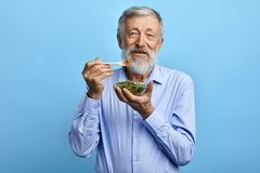 Happy bearded man eating salad,health care royalty free stock images