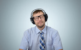 Happy bearded man listening to music with headphones Stock Photos