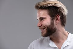 Happy bearded man looking to the side stock image