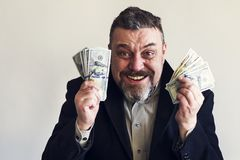 Happy Bearded Man With Dollars In His Hands. Success. Finance. Stock Photo