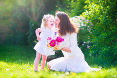 Happy beauiful mother and her daughter in garden Stock Photography