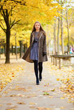 Happy beautful girl walking in park Royalty Free Stock Photos
