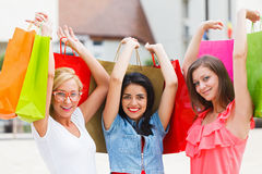 Happy Beauties Holding Bags Stock Image