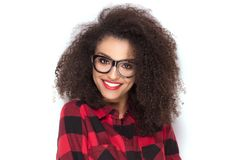 Happy afro girl in red checkered shirt. Happy beautiful african american girl with amazing toothy smile posing in checkered shirt. White background Royalty Free Stock Photos