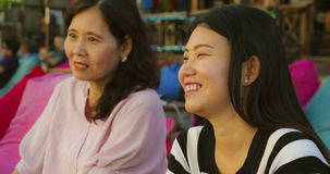 Happy and beautiful Asian Chinese woman enjoying Summer holidays travel together with her senior mature mother smiling cheerful. Lifestyle portrait of young royalty free stock photos