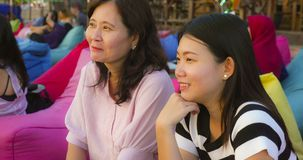 Happy and beautiful Asian Chinese woman enjoying Summer holidays travel together with her senior mature mother smiling cheerful. Lifestyle portrait of young royalty free stock photo