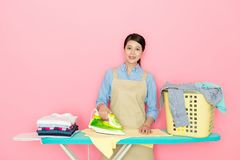 Happy beautiful Asian girl doing the ironing Royalty Free Stock Images