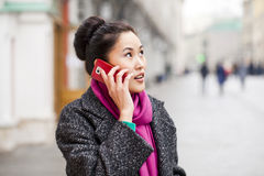 Happy beautiful asian woman calling by phone on the spring stree Stock Photos
