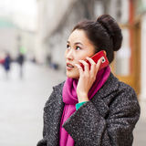 Happy beautiful asian woman calling by phone on the spring stree Royalty Free Stock Photography