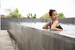 Happy beautiful asian woman enjoying time on the pool. A portrait of a Happy beautiful asian woman enjoying time on the pool Stock Photos