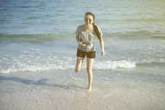 Happy beautiful asian woman having funny running on the beach.thai beach vacation.selective focus.light effect added.beach holiday Royalty Free Stock Photos