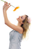 Happy beautiful blond model with a flower Stock Images