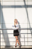 Happy beautiful blonde business woman in modern office. Royalty Free Stock Images