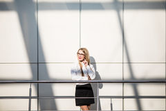 Happy beautiful blonde business woman in modern office. Stock Image
