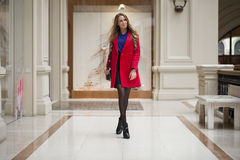 Happy beautiful blonde woman in red coat Royalty Free Stock Photo