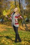 Happy Beautiful blonde woman walks in autumn park Stock Image