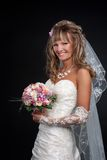 Happy beautiful bride on black background Stock Photography