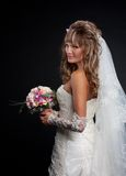 Happy beautiful bride on black background Stock Images
