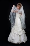 Happy beautiful bride on black background Royalty Free Stock Photo
