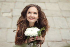Happy beautiful bride girl portrait looking up with wedding whit. E bouquet of flowers Stock Photography