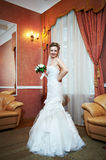 Happy beautiful bride in interior wedding palace Stock Photos