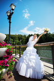 Happy beautiful bride in park Stock Photography