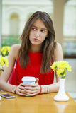 Happy Beautiful brunette girl sitting in a coffee shop Stock Images