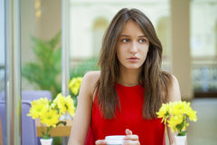 Happy Beautiful brunette girl sitting in a coffee shop Stock Image