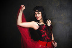 Happy Beautiful brunette woman in corset and long hair with bott Royalty Free Stock Photos