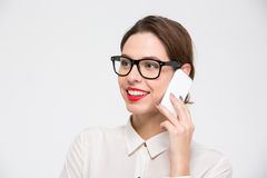 Happy beautiful business woman in glasses talking on mobile phone Stock Photography