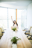 Happy and beautiful business woman in the office with arms up victory Royalty Free Stock Images