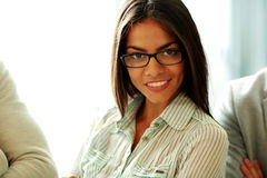 Happy beautiful businesswoman in glasses Stock Photo