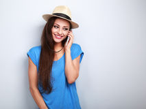 Happy beautiful casual woman talking on mobile phone in summer h Stock Photo