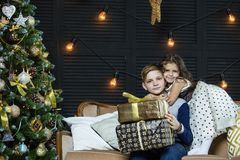 Happy beautiful children boy and girl with gifts to celebrate Ch stock photography