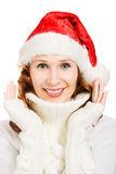 Happy Beautiful Christmas woman in santa hat. On a white background Royalty Free Stock Photos